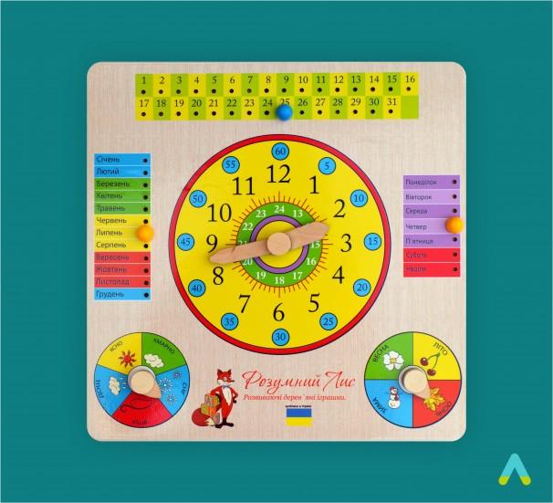 Годинник та календар на дерев'яному планшеті - фото
